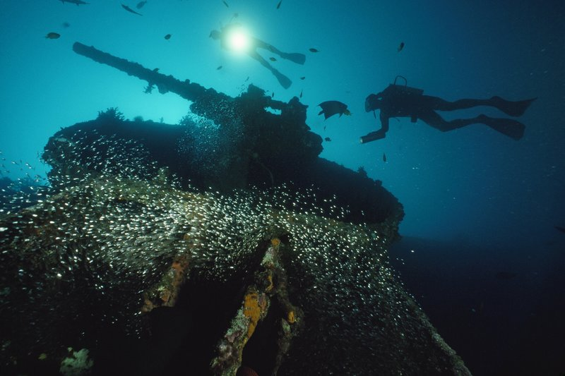 VANUATU - JANUARY 01: Divers explore the U.S.S. President Coolidge's forward guntub. Pacific Ocean, Off Luganville, Espiritu Santo Island, Republic Of Vanuatu (Photo by David Doubilet/National Geographic/Getty Images)