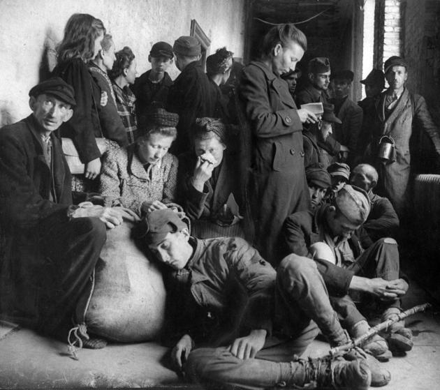 Exhausted, homeless German refugees huddled in a city municipal building seeking shelter. (Photo by Leonard Mccombe/The LIFE Images Collection/Getty Images)
