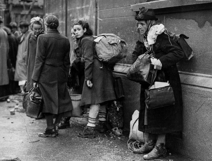 German civilian refugees prepare to flee war-torn Aachen, Germany as the battle for the doomed city draws to a close, Oct. 24, 1944. The refugees have been living in air-raid shelters as the battle for the city rages on. The Americans have about 4,000 of these refugees on their hands, who are being taken to a camp in Belgium and temporarily housed in a large school. (AP Photo/Keystone)