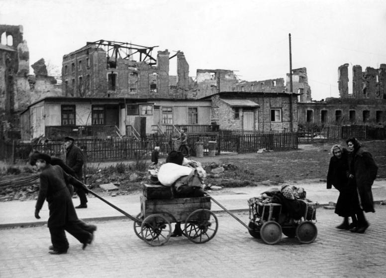 War refugees walking through Berlin with their whole belongings on 15th December 1945. Photo by: dpa DANA/picture-alliance/dpa/AP Images