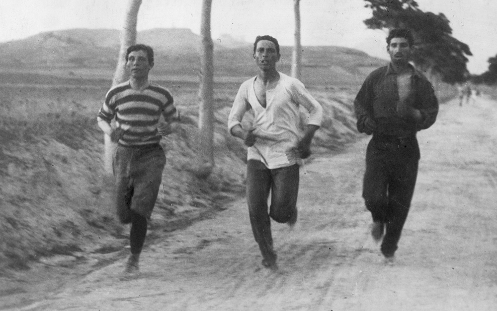 1896: Three athletes in training for the marathon at the Olympic Games in Athens. (Photo by Burton Holmes/Henry Guttmann/Getty Images)